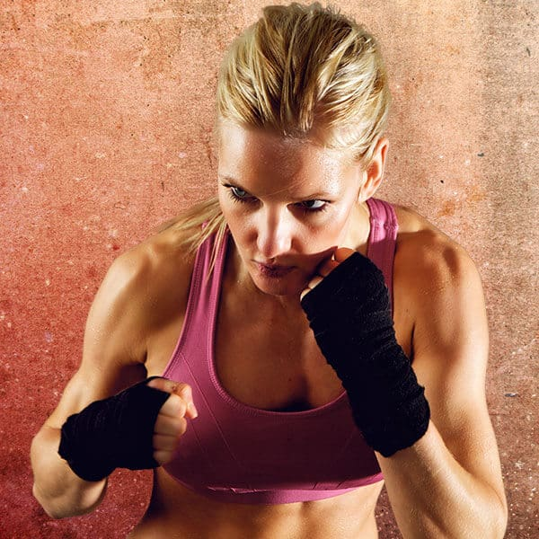 Mixed Martial Arts Lessons for Adults in Carmichael CA - Lady Kickboxing Focused Background