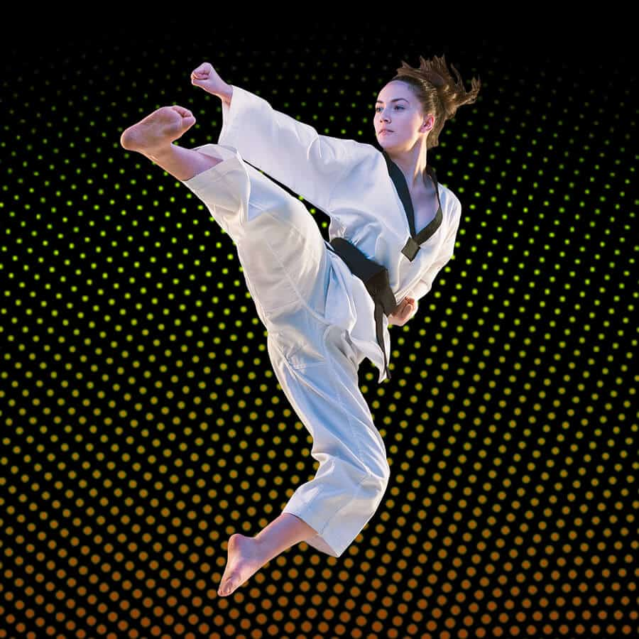 Martial Arts Lessons for Adults in Carmichael CA - Girl Black Belt Jumping High Kick