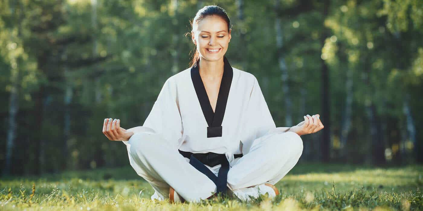 Martial Arts Lessons for Adults in Carmichael CA - Happy Woman Meditated Sitting Background