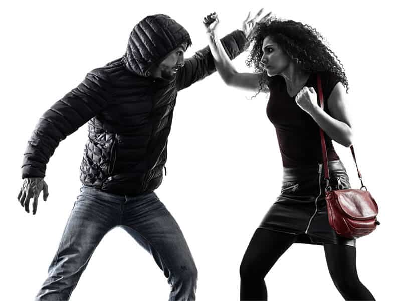 Self-Defense Program for Adults in Carmichael CA - Blocking Punch Woman